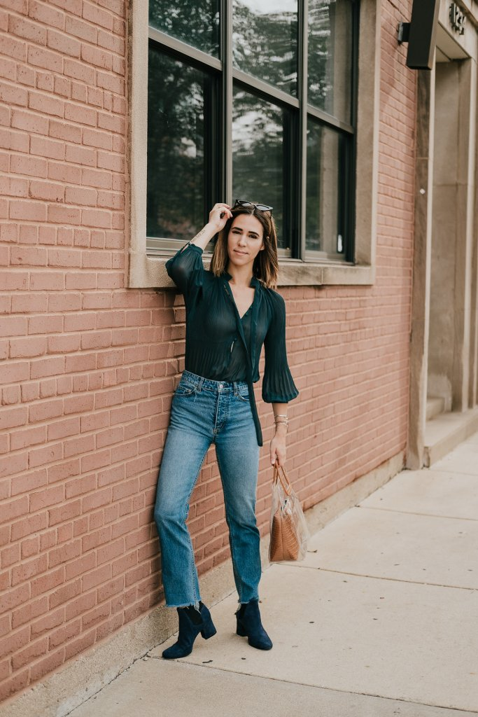 Blogger Mary Krosnjar wearing Wedgie Icon Denim and Clear Bag
