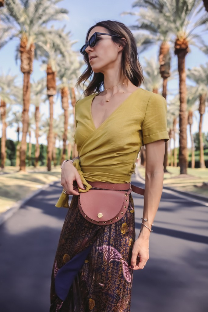 Blogger Mary Krosnjar wearing J.O.A. wrapped crop top and See by Chloe Convertible Bag
