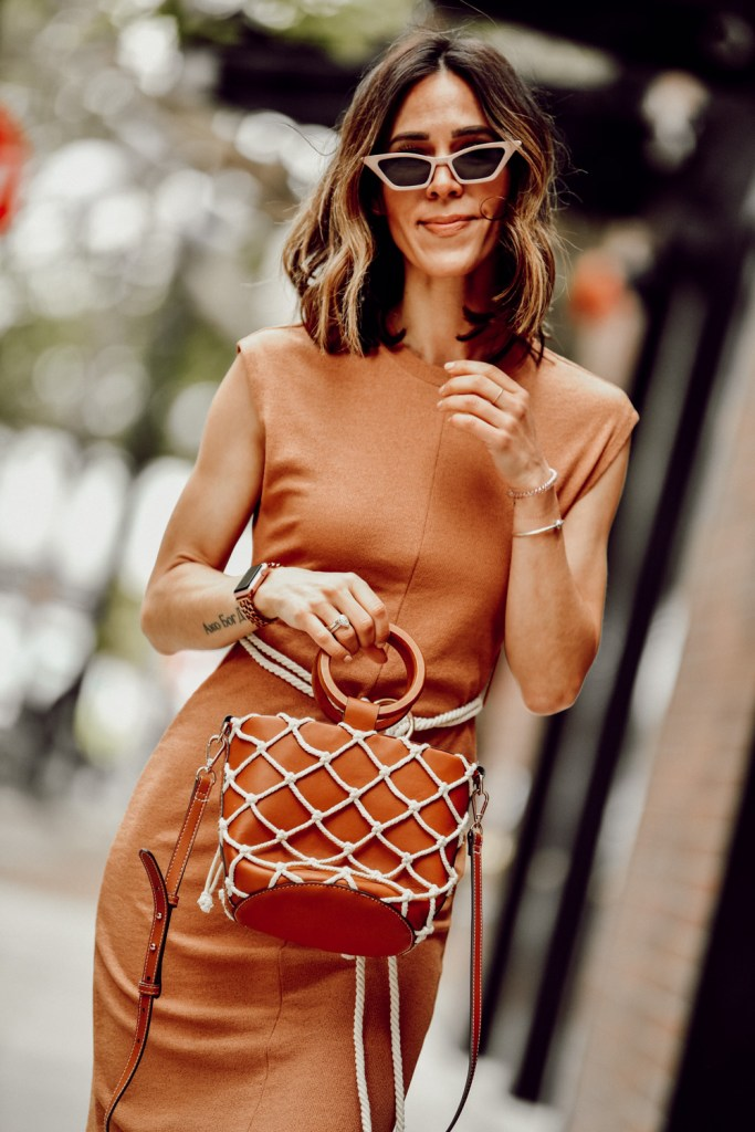 Fashion Blogger Sportsanista wearing tan knit midi dress and net bag for summer style inspiration look
