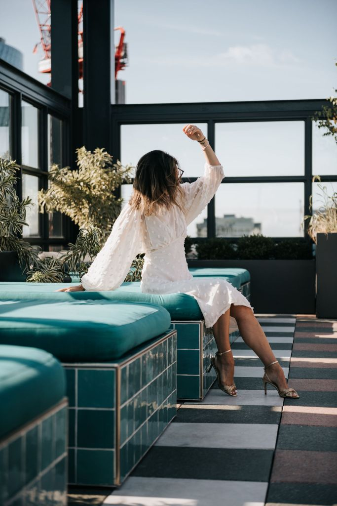 Fashion Blogger Sportsanista wearing Chicwish Cotton Candy Sheer Maxi Dress in Cream and Nude Sandals on Chicago Rooftop