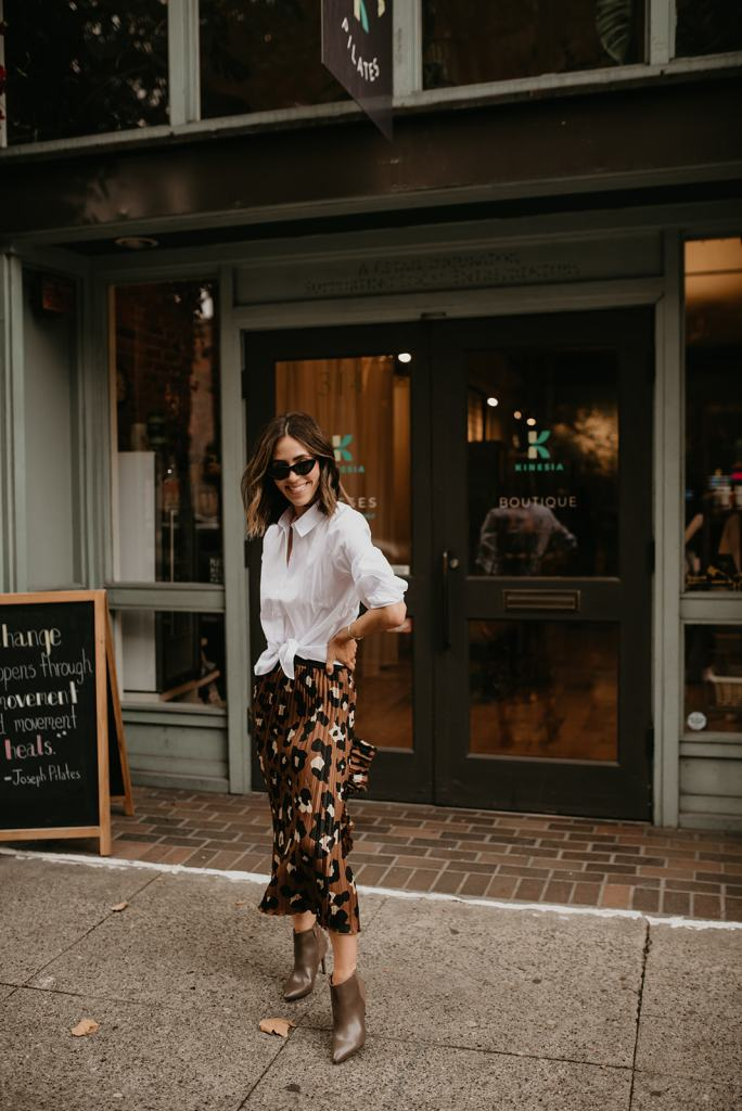 Seattle Fashion Blogger Sportsanista wearing White Collared Blouse and Leopard Pleated Skirt from JcPenny for Work