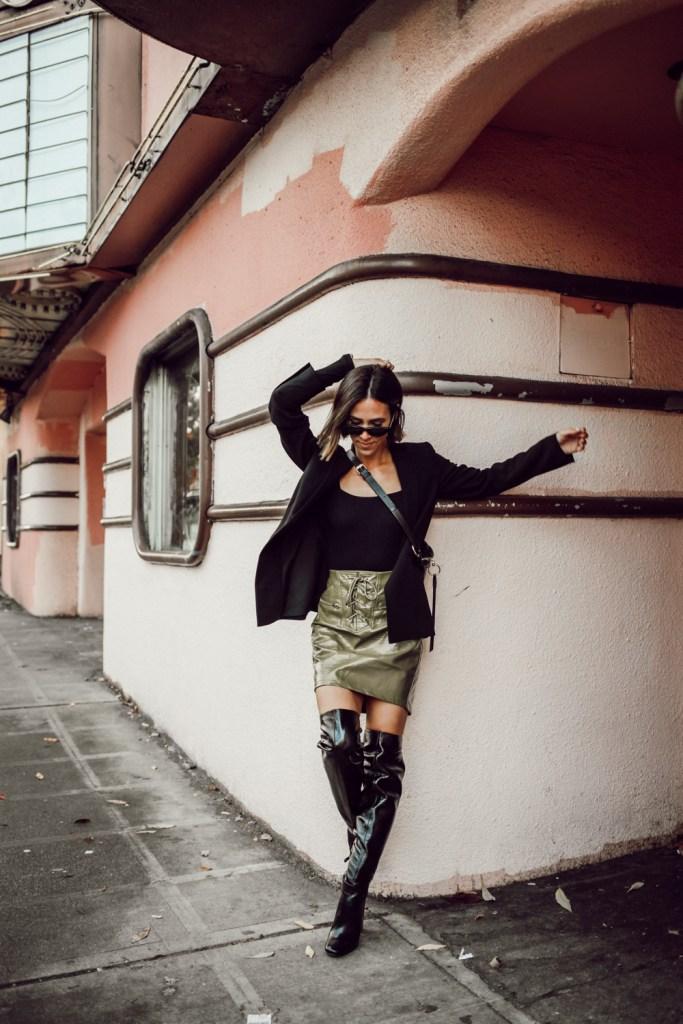 Blogger Mary Krosnjar wearing Ann Taylor Oversized Blazer and BCBG OTK Boots