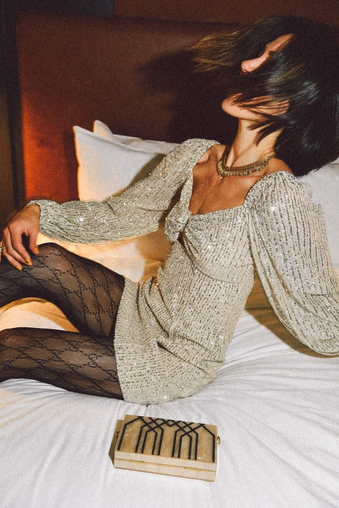 Blogger Mary Krosnjar wearing Lustre Long Sleeve Sequin Mini Dress and Gucci interlocking tights