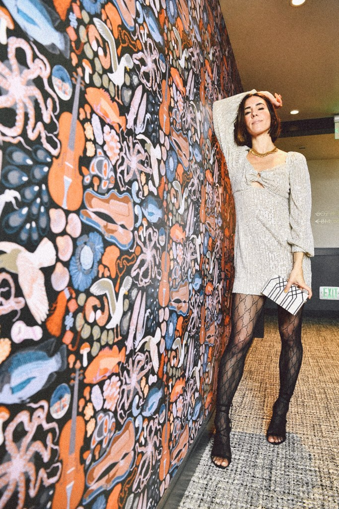 Blogger Mary Krosnjar wearing Gucci Interlocking tights and Lustre Long Sleeve Sequin Mini Dress