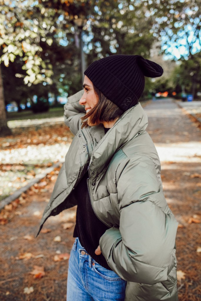 Mary Krosnjar wearing The Drop Women's Julie Ribbed Beanie Hat and The Drop Women's Dani Recycled Poly Puffer Jacket