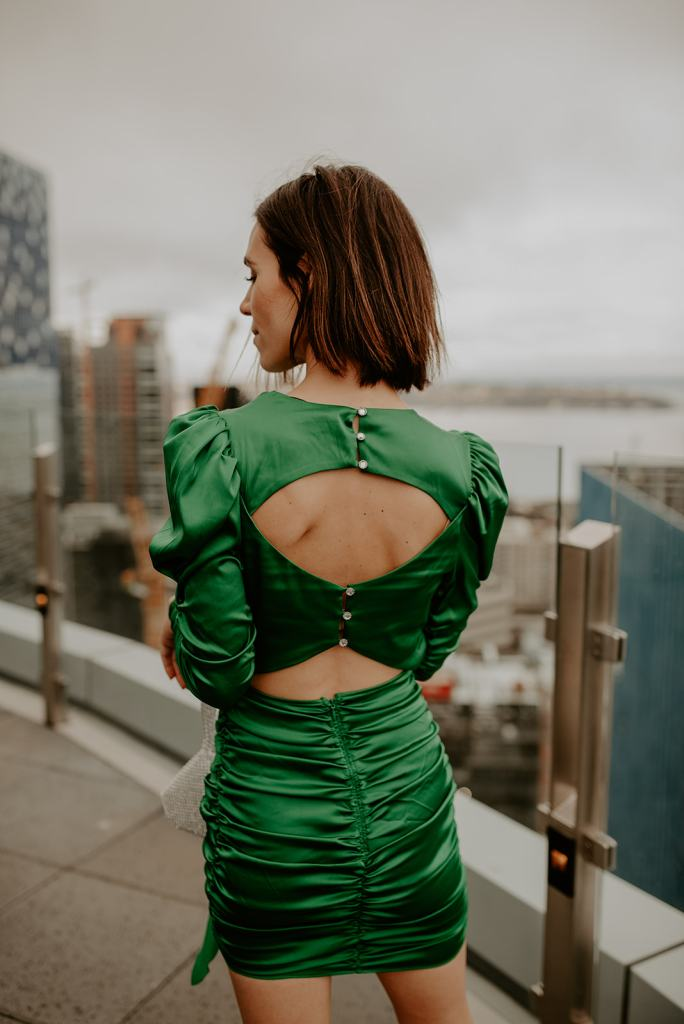 Blogger Mary Krosnjar wearing open back satin dress for new years eve