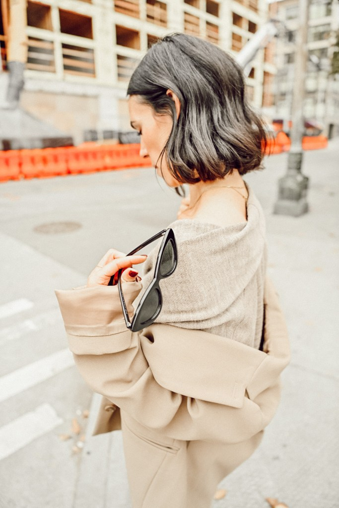 Blogger mary krosnjar wearing jumpsuit and oversized blazer for fall look