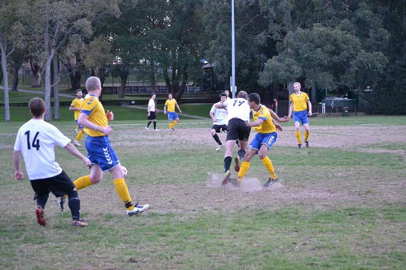 A successful tackle for Sydney University FC.