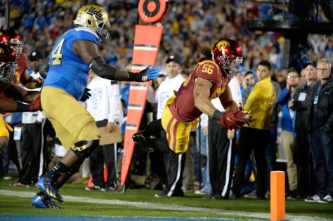USC LB Anthony Sarao with a pick-six against UCLA in 2014 (Harry How/Getty Images North America)