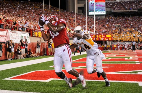 Jamal Turner catches a touchdown pass against Wyoming in 2013 (Eric Francis/Getty Images North America)