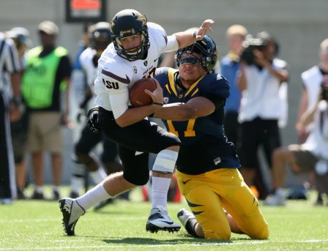 Brennan Scarlet sacks Taylor Kelly of Arizona State in 2012 (Ezra Shaw/Getty Images North America)