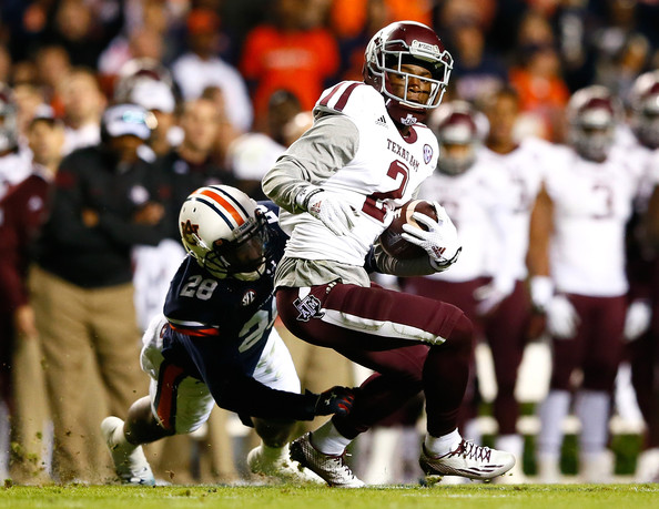 T.J. Davis tries to tackle Texas A&M's Speedy Noil (Kevin C. Cox/Getty Images North America)