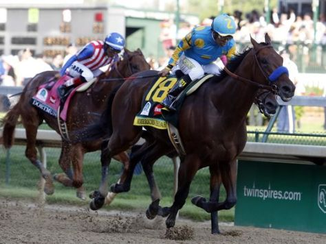 Victor Espinoza guides American Pharoah to a one length victory in the 2015 Kentucky Derby (Peter Casey / USA TODAY Sports)