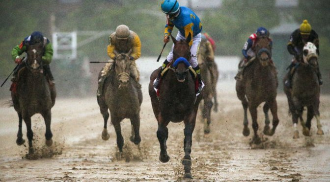 American Pharoah Wins Preakness Easily In The Slop