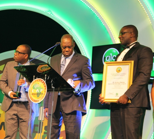 President, Ghana Football Association, Mr. Kwesi Nyantakyi (left) receiving the 2014 Glo/CAF Platinum Award on behalf of late Ghanaian President Kwame Nkrumah jointly presented by Globacom's National Sales Coordinator, Lagos and Mid-West Teritorries, Mr. David Maji and CAF President, Alhaji Issa Hayatou at the 2014 Glo/CAF Awards ceremony held in Lagos, Nigeria