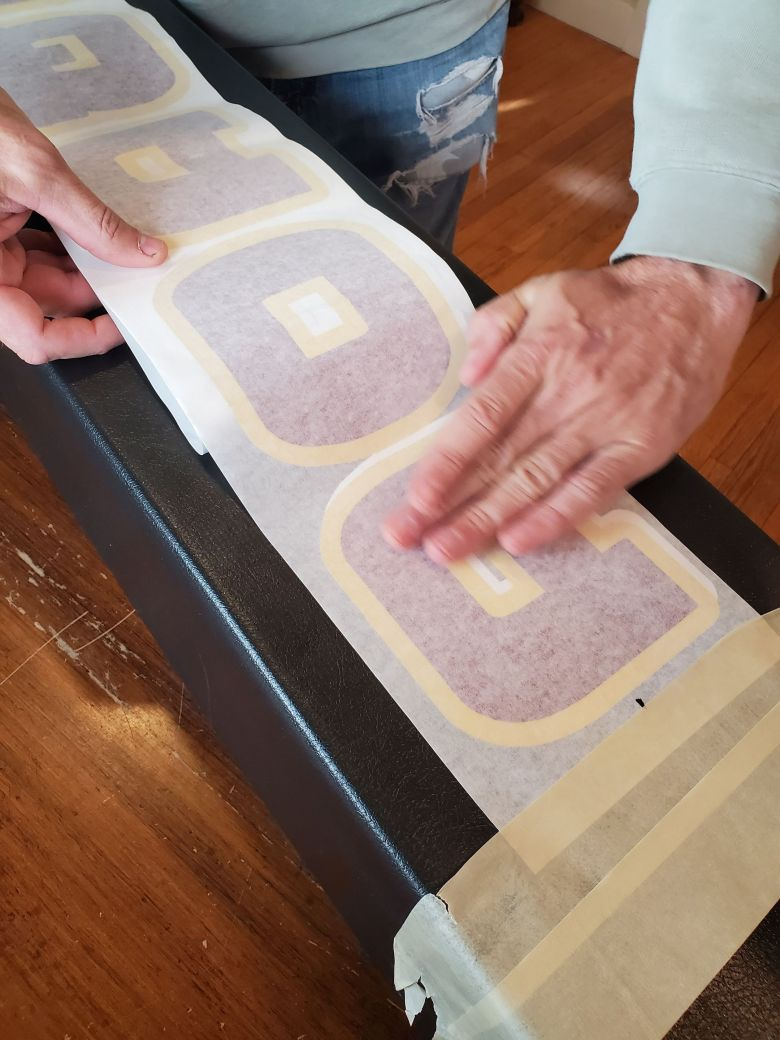 sports-installer-basketball-pole-pad-lettering-applying