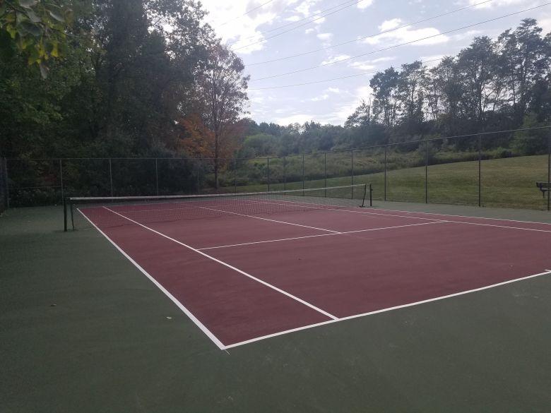 sports-installer-tennis-court-rust-spot-colors
