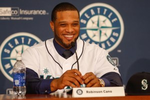 SEATTLE, WA - DECEMBER 12:  Robinson Cano of the Seattle Mariners is introduced to the media during a press conference at Safeco Field on December 12, 2013 in Seattle, Washington.  (Photo by Otto Greule Jr/Getty Images)