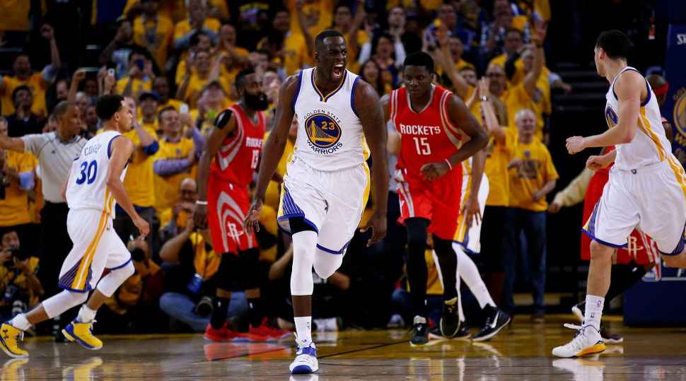 OAKLAND, CA - MAY 19: Draymond Green #23 of the Golden State Warriors celebrates in the second quarter against the Houston Rockets during Game One of the Western Conference Finals of the 2015 NBA Playoffs at ORACLE Arena on May 19, 2015 in Oakland, California. NOTE TO USER: User expressly acknowledges and agrees that, by downloading and or using this photograph, user is consenting to the terms and conditions of Getty Images License Agreement. (Photo by Ezra Shaw/Getty Images)
