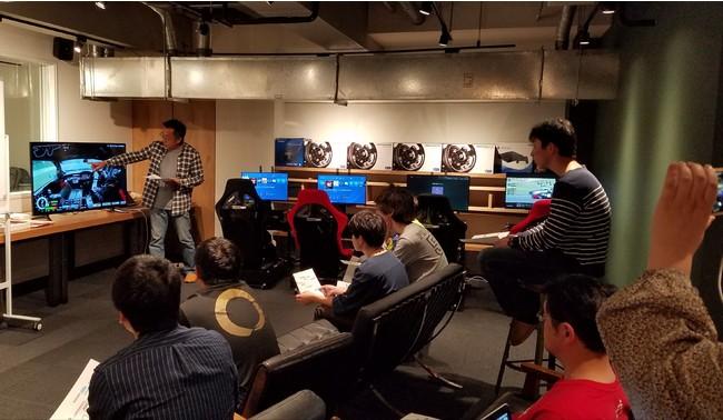プロドライバー大井貴之氏による本物のサーキット走行映像を使った講習会