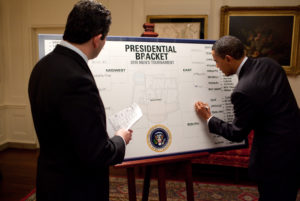 ESPN's Andy Katz watches as President Barack Obama fills out his 2010 NCAA Men's Basketball Tournament bracket in the Map Room of the White House, March 16, 2010. (Official White House Photo by Pete Souza)