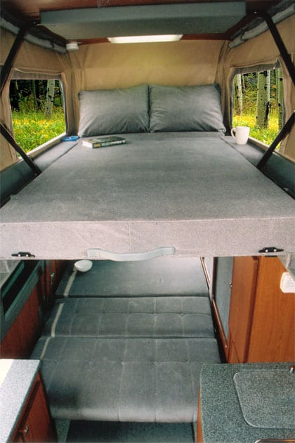 An Interior View Of A Custom Sportsmobile Camper Van Conversion With Upstairs Bed Option