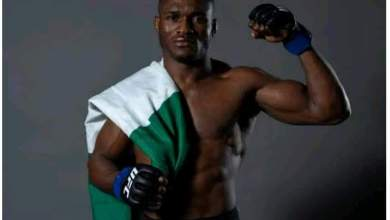 Photo of Kamaru Usman beats Tyrone Woodley to become the 1st African UFC title winner