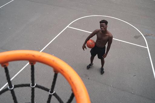 https://www.pexels.com/photo/man-standing-near-basketball-hoop-holding-a-basketbal-3534924/