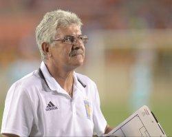 El Tuca walks off the field after tigres beat santos 3-0