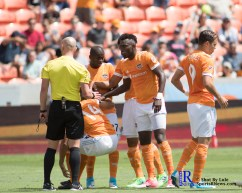 the team helps out Houston Dynamo Midfielder Alex #14 During a match between the Houston Dynamo vs San Jose Earthquakes, Goals from Houston Dynamo Forward Erick Torres #9and Houston Dynamo Forward Alberth Elis #17 Would earn the dynamo a win by a score of 2 to 0.April 22,2017 BBVA Compass Stadium