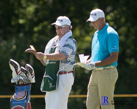 Tom Lehman with Caddy check yardage before taking his shot During the first round of the Insperity Invitational Golf Tournament, TPC The Woodlands.