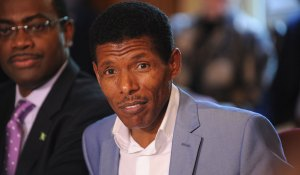 """Olympic great Haile Gebrselassie speaking at the Olympic hunger summit in Downing Street, 12 August 2012. Photo by Flickr user """"Foreign and Commonwealth Office"""""""