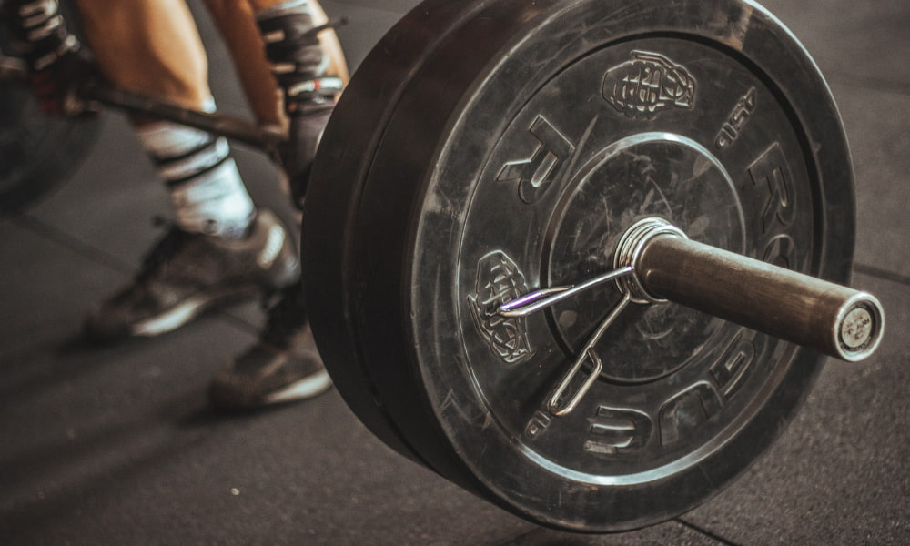 person getting ready to lift weights