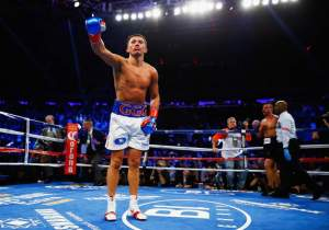 Golovkin (left) celebrates his victory