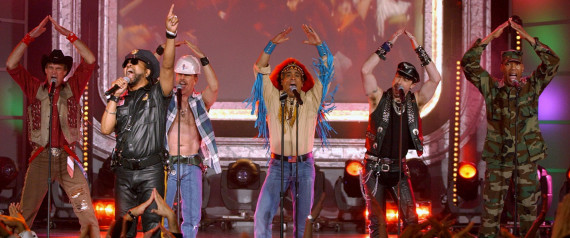 """The Village People, with lead singer Ray Simpson, second from left, perfom the song """"YMCA"""" during taping of the American Bandstand's 50th anniversary show Saturday, April 20, 2002, in Pasadena, Calif. Members of the group, from left, are Jeff Olson, Simpson, David Hodo, Felipe Rose, Eric Anzalone and Alexander Briley. (AP Photo/Kevork Djansezian)"""