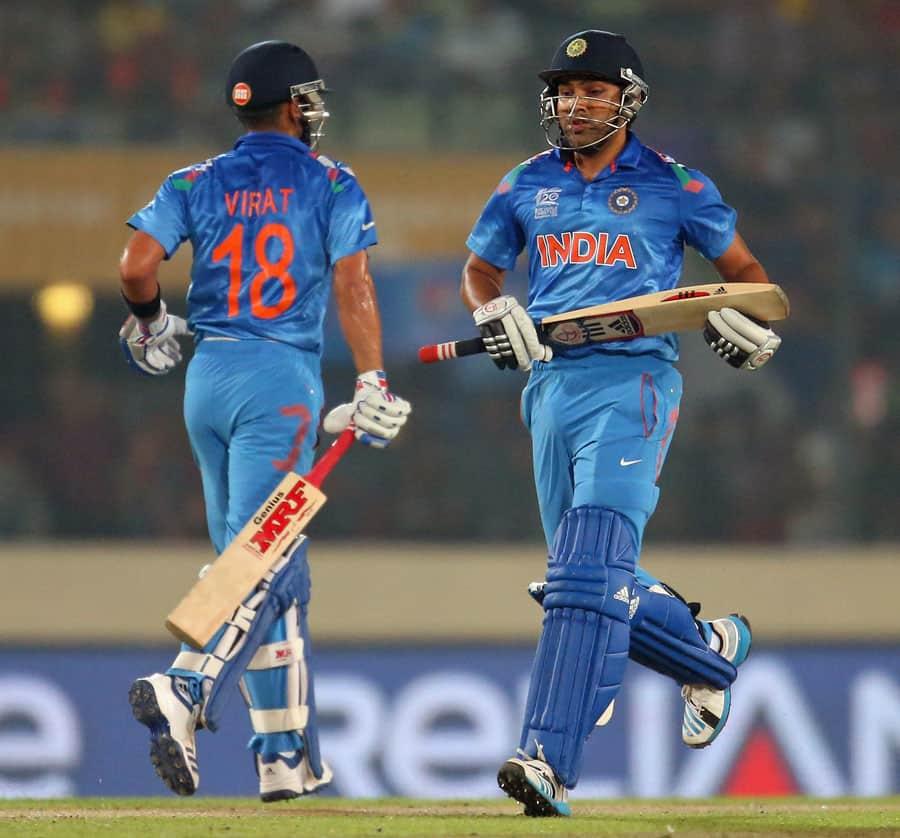 Virat Kohli and Rohit Sharma joggs a run during their 100 runs partnership