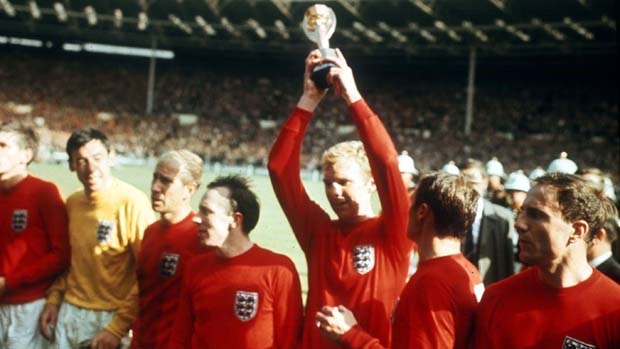 World Cup Final, 1966 Wembley, England. 30th July, 1966 England 4 v West Germany 2. England's captain Bobby Moore holds aloft the Jules Rimet World Cup trophy after his team defeated West Germany in the Final. L-R are: Martin Peters, Gordon Banks, Bobby