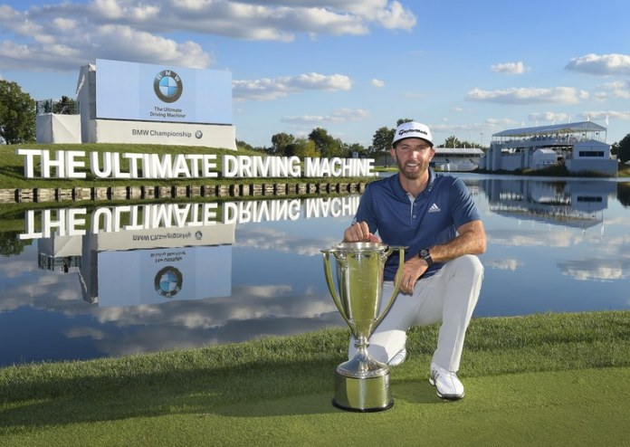 Dustin Johnson with his BMW Championship Trophy