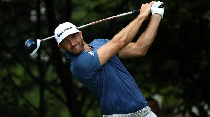 Photo of Dustin Johnson as he swings a golf club