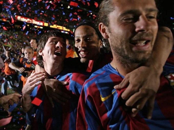 Lionel Messi, Ronaldinho and Rafael Marquez of Barcelona celebrating 2006 Spanish League win