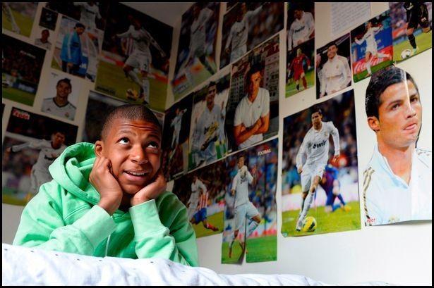 Kylian Mbappé room coverd with photos of Cristiano Ronaldo