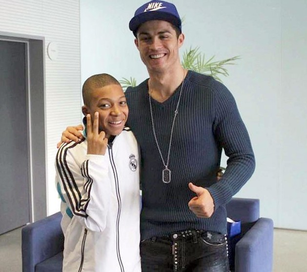 Photo of young Kylian Mbappé with Cristiano Ronaldo