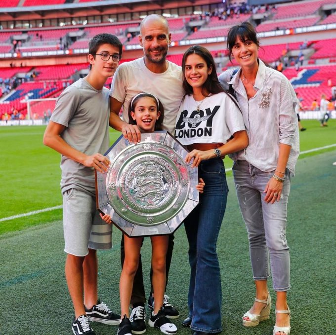 Pep Guardiola with his wife and kids