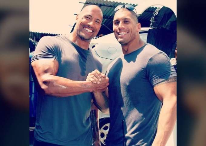 Photo of Dwayne Johnson with his cousin/stuntman, Tanoai Reed