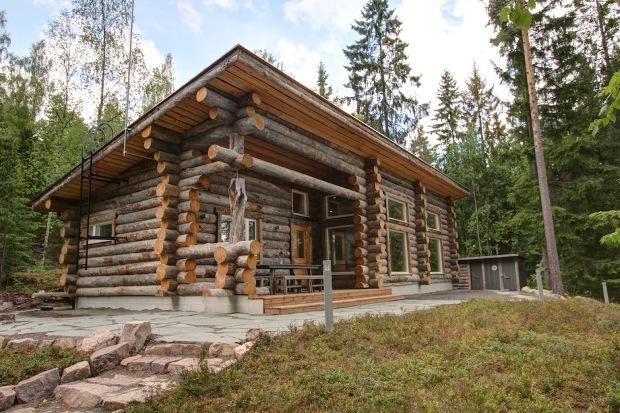 O casa din busteni rotunzi, de 90 mp