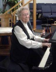 Miss Ella at the piano