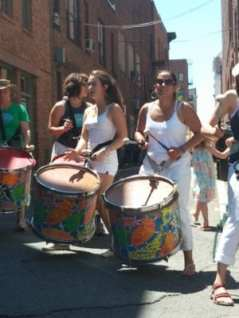 Members of Troy Samba beat their drums as part of a live performance during Troy River Fest on Saturday, June 18.