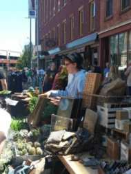A plant vendor talks to a customer about a purchase during Troy River Fest on Saturday, June 18.