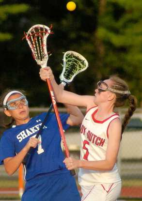 Shaker's Lauren Martuscello, left, and Guilderland's Kerry Gerety get the Section 2 Class A girls lacrosse final started with the center draw. Rob Jonas/Spotlight