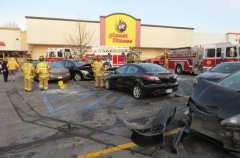 An accident in the Glenmont Plaza parking lot Monday, Dec. 26, damaged several vehicles and utility trailers. Photo by Tom Heffernan Sr.